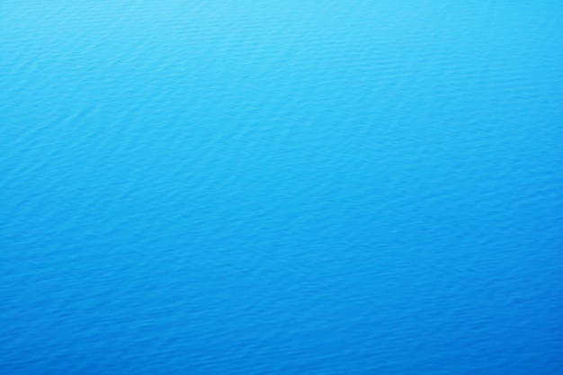 The smooth natural blue water background with bokeh