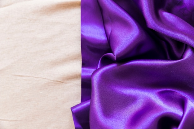 Smooth purple fabric on plain textile