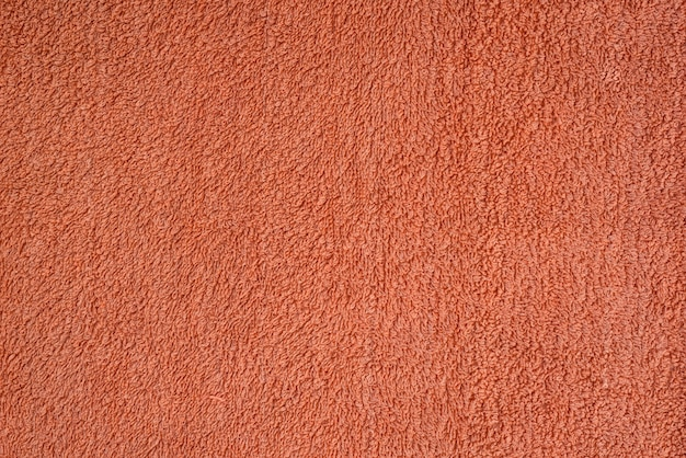 Smooth seamless texture of a terry towel. coral color