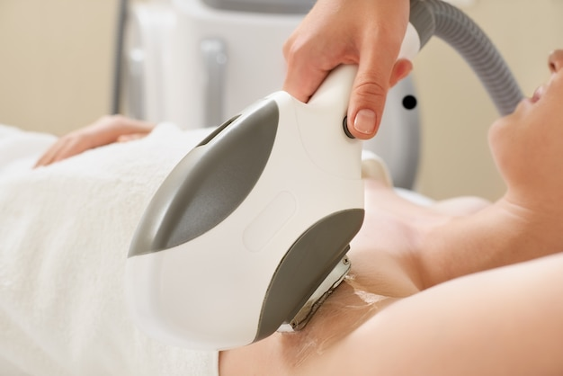 Smooth skin under the arms. woman on laser hair removal