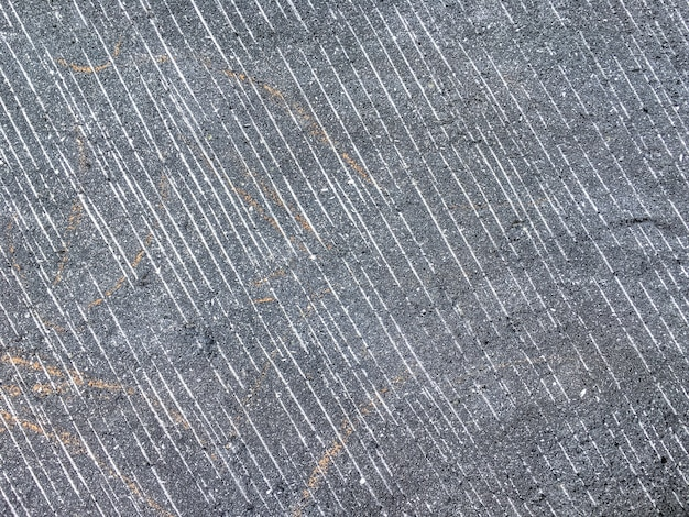 Smooth surface of the old gray stone in a section. ancient background.