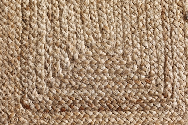 Smooth texture at the bottom of wicker straw basket. extreme closeup of a vintage wicker texture.