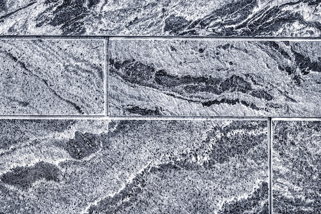 Гладкая плитка на стене с текстурой фона