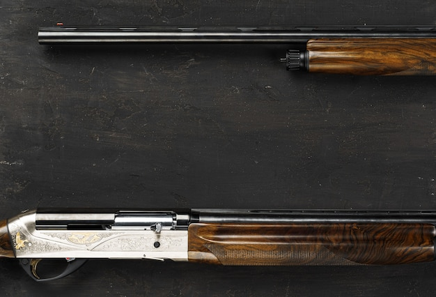 Smoothbore hunting gun on black background close up
