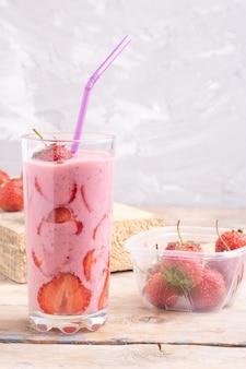Smoothie balls, frozen treats in glass, stick to drink. strawberries