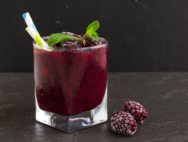 Smoothie of blackberries and currants. on dark background.