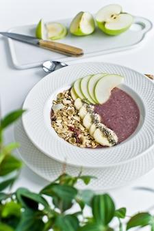 Smoothie bowl with banana, apple, chia seeds, oatmeal and yogurt.