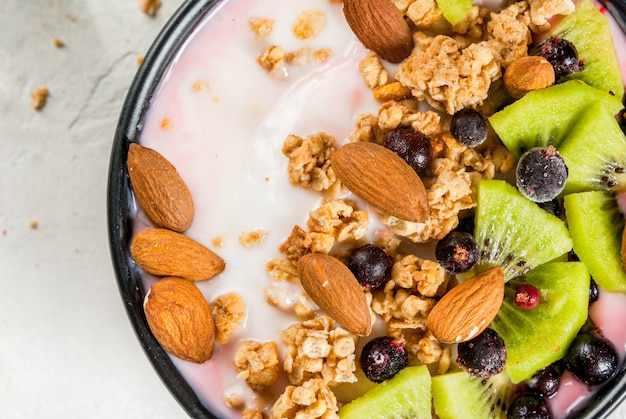 Smoothie bowl with fruits and nuts