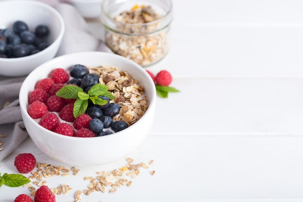Smoothie bowl with yogurt, fresh aromatic berries and cereal