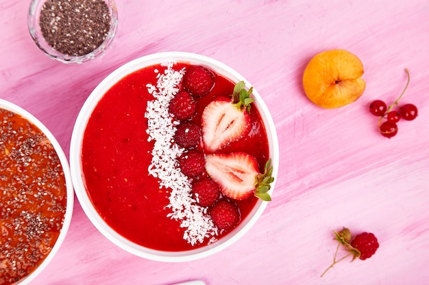 Smoothie bowls. healthy breakfast bowl on pink background.