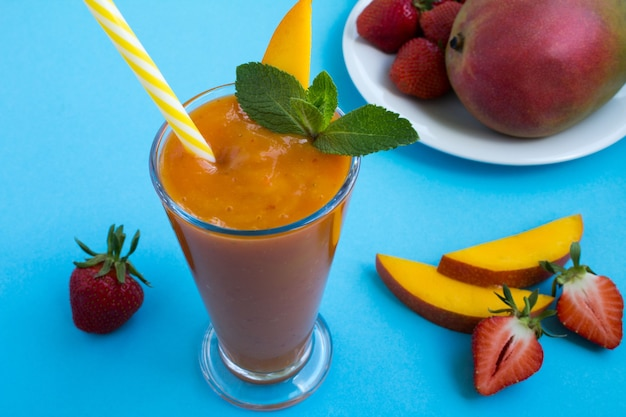 Smoothie  from  mango and strawberry  on the  blue background