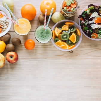 Smoothie and fruits near healthy dishes
