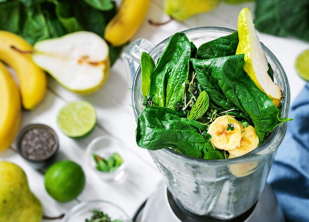 Smoothie with fresh fruits, green spinach and superfood seeds