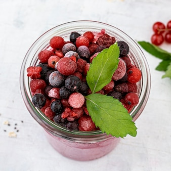 Smoothie with frozen fruits high angle