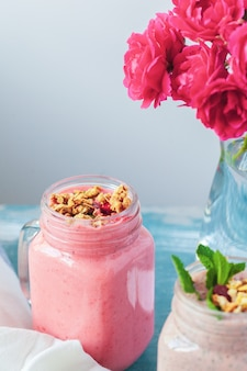 Smoothie with granola for healthy breakfast. selective focus