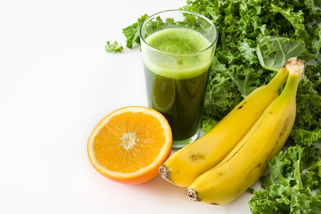 Smoothie with kale,banana and orange isolated on white copy space