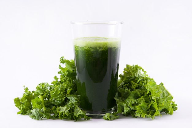 Smoothie with kale in glass isolated on white background