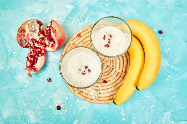 Smoothie with oat or oatmeal, banana and pomegranate