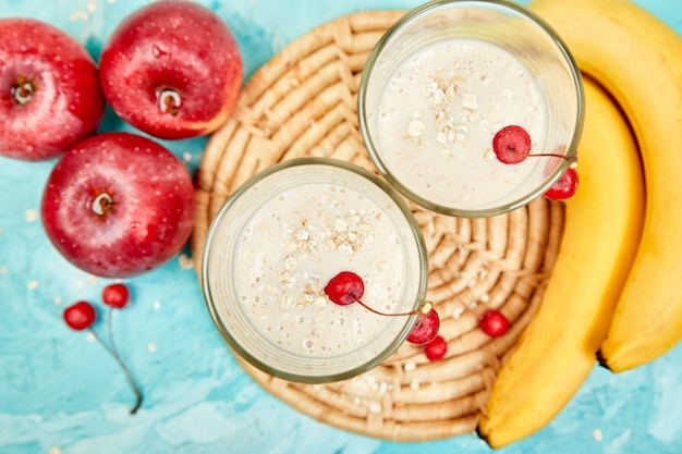 Smoothie with oat or oatmeal, banana and  red apples