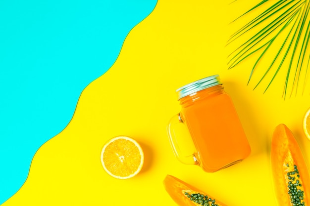 Smoothies / cocktail / juice on a bright pastel, summer concept.