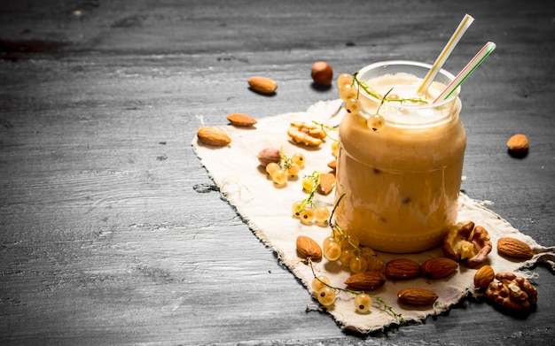 Smoothies fromwhite currants and nuts. on the black chalkboard.