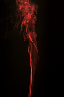 Smoothly flowing smoke against black background