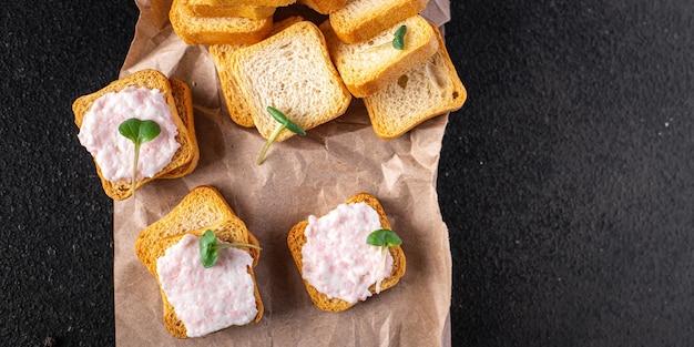 Smorrebrod sandwich butter spread shrimp on bread capelin caviar seafood fresh meal snack