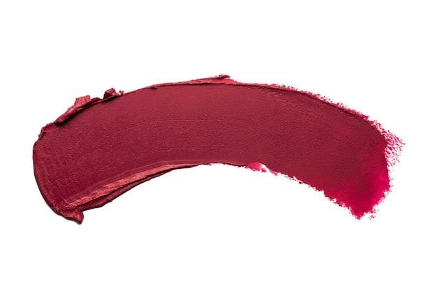 Smudged dark red claret maroon matte lipstick swatch isolated on white background