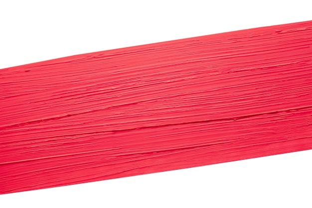 白い背景で隔離の汚れた赤いマットな口紅見本