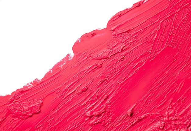 Smudged red pink matte lipstick swatch thick texture isolated on white background