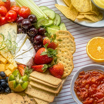 Snack board with cheese and crackers close up