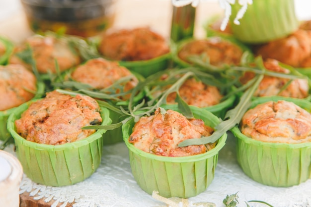 Snack of cheese cake with greens in small cupcake form.