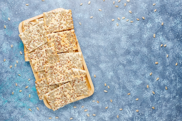 Snack cookies with sunflower seed,linen seed,sesame seeds on grey table