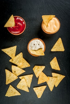 Snack for party, chips, nachos with sauces