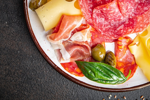 Snack plate meat sausage cheese ham olives fresh portion ready to eat meal appetizer