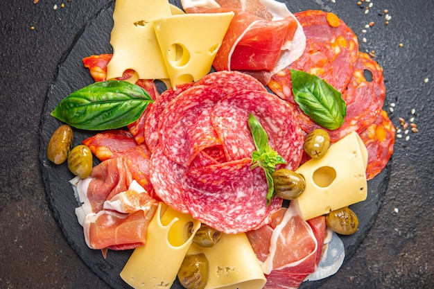 Snack plate sausage meat cheese ham olive fresh meal appetizer on the table copy space food