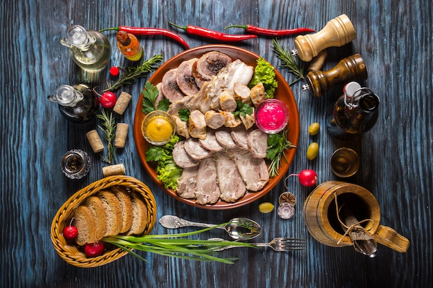 Snack set. assorted sliced meat with spices on rustic wooden backgrounds