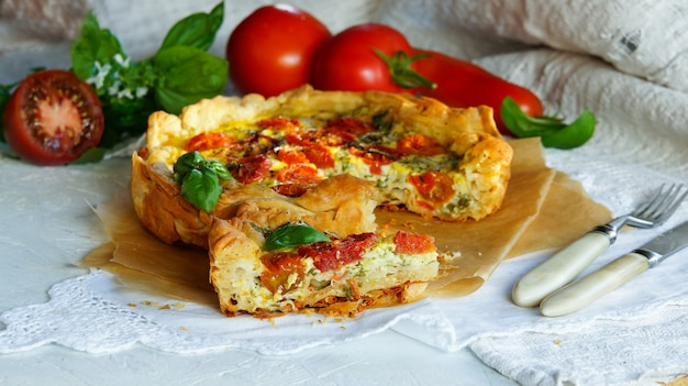 Snack tart from homemade filo dough with mozzarella, basil, tomatoes and garlic
