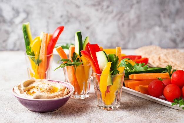 Snacks bar.  vegetables sticks and hummus