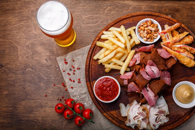 Snacks for beer or alcohol and it includes smoked pork meat, french fries, fried bread, crab sticks and nuts