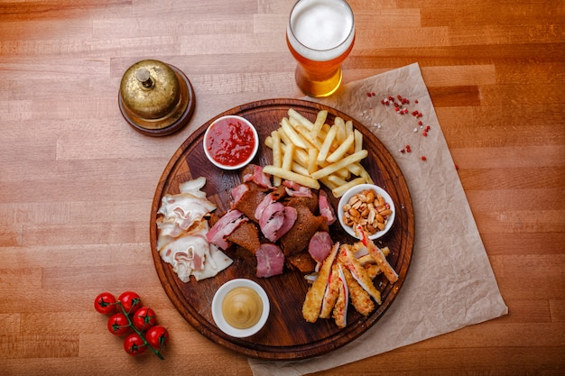 Snacks for beer or alcohol and it includes smoked pork meat, french fries, fried bread, crab sticks
