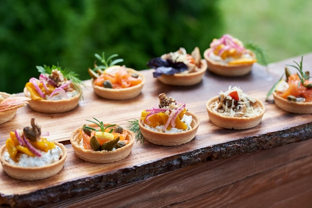 Snacks of tartlets with different fillings of figs, cheese,