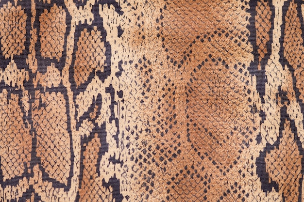 Snake skin background, close up, beige and brown texture