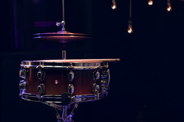 Snare drum in the dark with copy space. musical creativity concept.