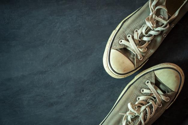 Sneaker on black cement floor.