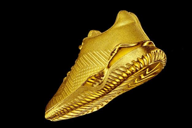 Sneakers. golden sneaker on black