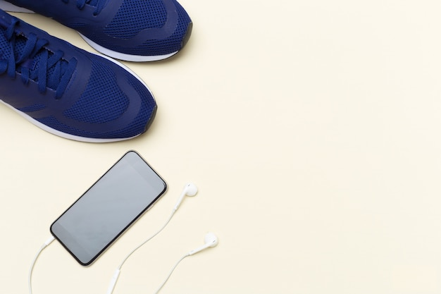 Sneakers and mobile phone with headphones