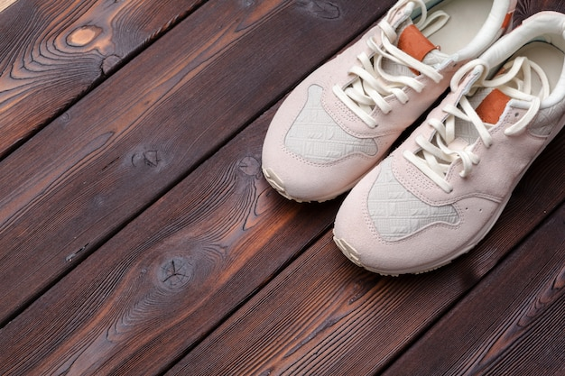 Sneakers on old retro wooden background.