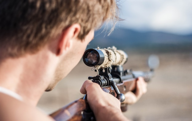 Sniper aim at a target of sniper rifle