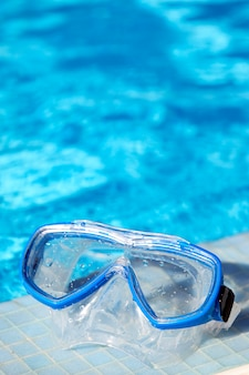 Snorkel goggles and water of swimming pool